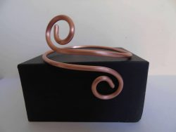 wire bangle on black presentation box
