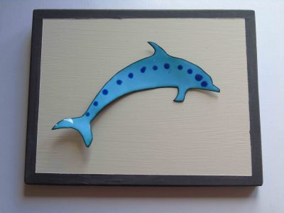 blue enamelled dolphin with darker blue spot wall hanging