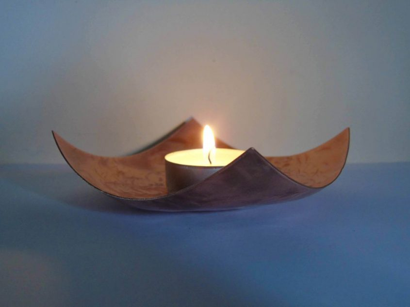 sqaure shaped copper bowl being used as a tealight holder