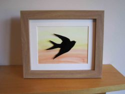 enamelled swallow in frame