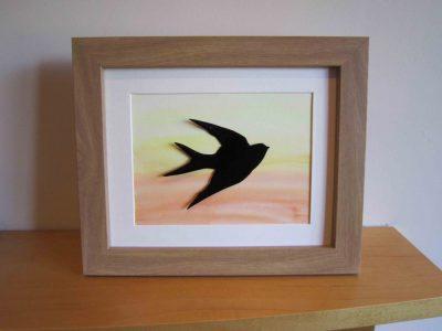 enamelled swallow in frame