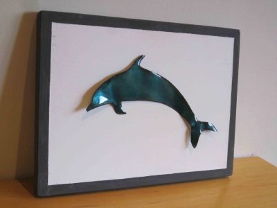 enamelled dolphin on painted wooden board