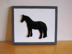 black enamelled horse on painted wooden board