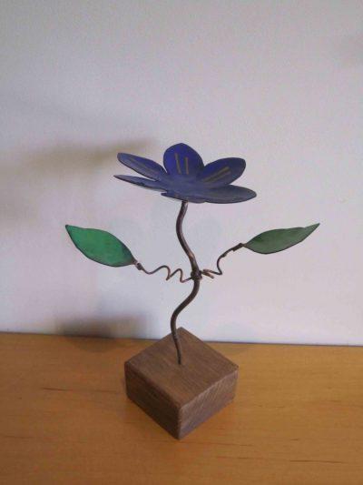 blue enamelled clematis flower