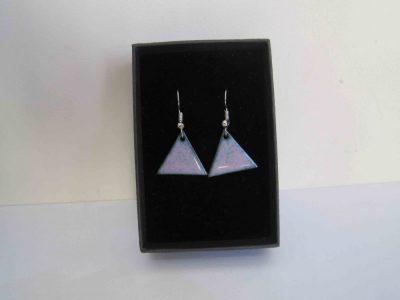 pink triangular earrings in black presentation box