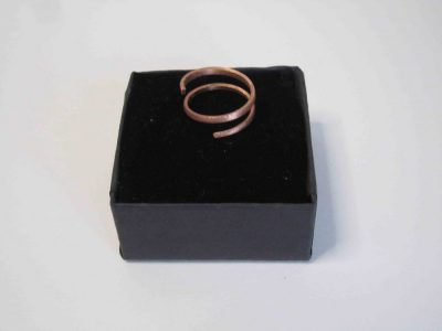 Small spiral copper ring on presentation box