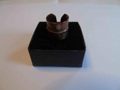 small cuff ring on its box