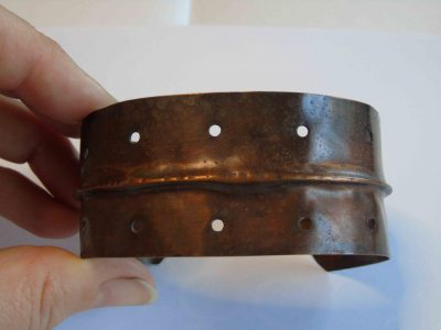 dark cuff bracelet showing fold and holes
