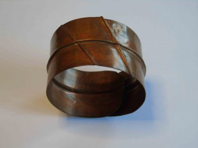 Overlapping bracelet with fold forming