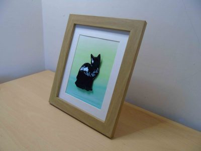enamelled copper cat silhouette or black cat at a slight angle