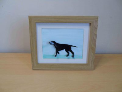 enamelled copper labrador or pointer dog in a frame with a watercolour green background