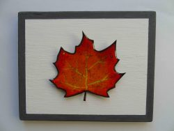 Enamelled leaf in reds, oranges and yellows