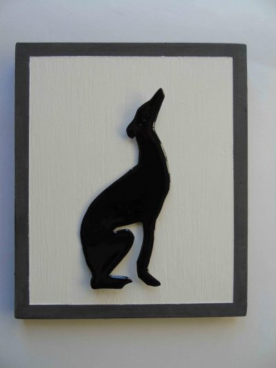 Black enamelled greyhound on white and grey painted wooden mount