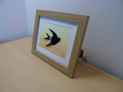 enamelled copper swallow wall hanging slightly sideways on to show the bird is slightly 3d