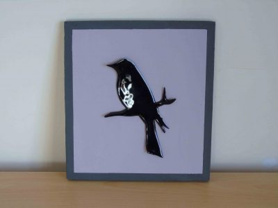 Blackbird on mauve painted wooden board