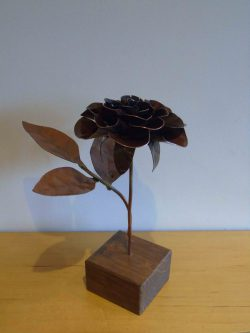 Coper rose with dark patina