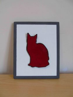 Enamelled red cat
