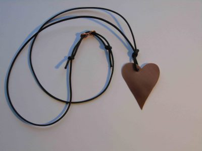 Copper heart necklace showing adjustable waxed cord