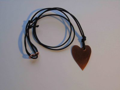 Copper heart necklace showing waxed cord 'chain'